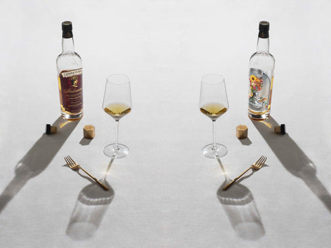 Compass Box whisky bottles with tasting glasses