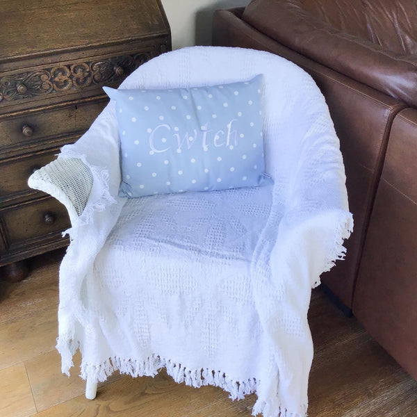Cwtch Cushion Powder Blue on chair
