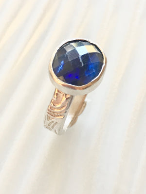 "sapphire colored faceted oval cut Kyanite  ring set in  sterling silver.   This faceted cut is referred to as a ""rose cut"""