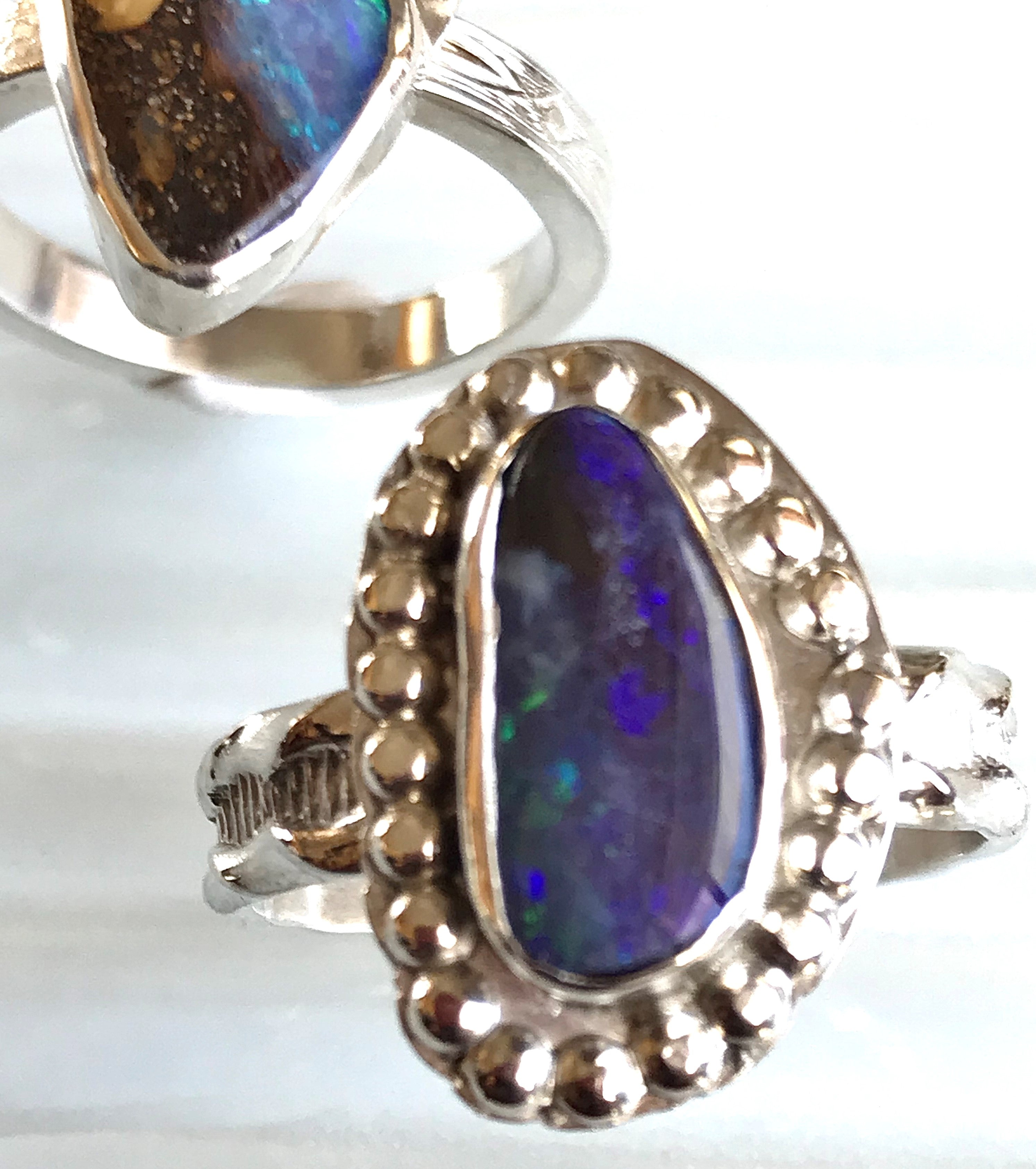 "Australian Boulder Opal ring set in sterling silver with small silver balls around the opal to look like the opal is surrounded on ""dots"".  the color of this opal is a combination of periwinkle  & navy blue.  size 7.75"