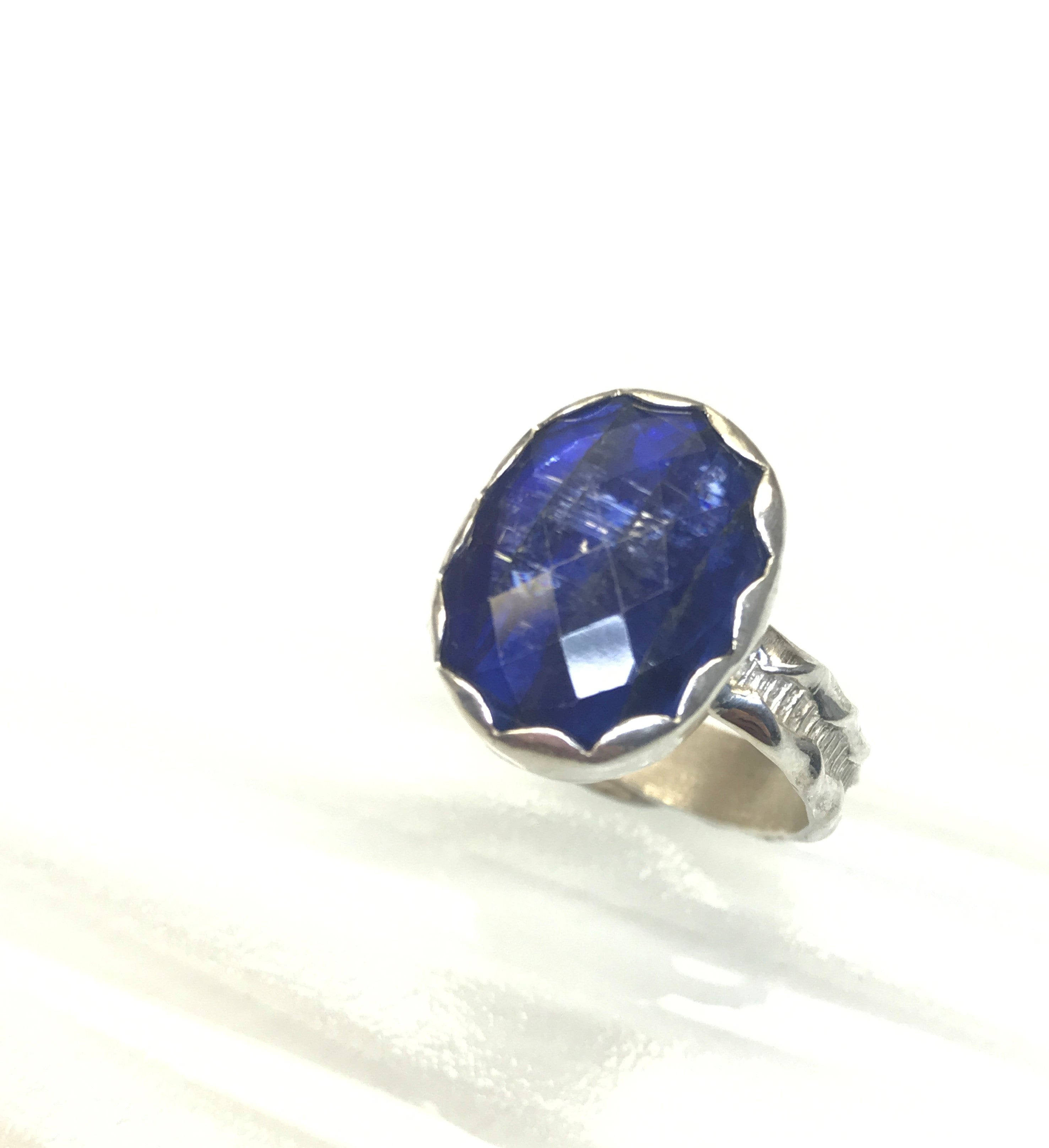 royal Blue Kyanite rose cut sterling silver ring.  The oval cut kyanite is a slighly smaller than an American nickel.  The blue is similar to a rich sapphire color.  A very pretty ring in a size 8