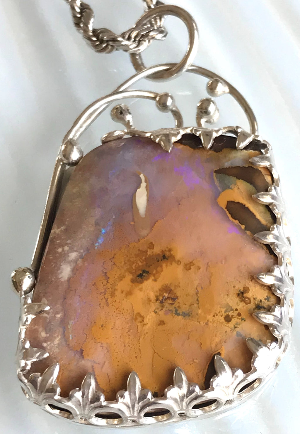 pastel Australian boulder opal pendant set in sterling silver  accented with silver balls