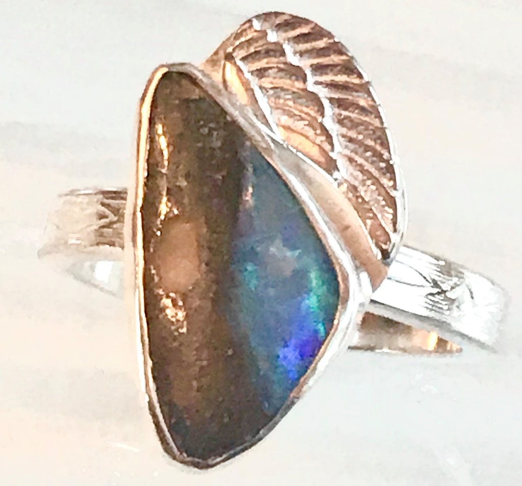 sterling silver angel wing cradles to an opal ring