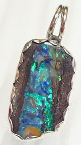 blue flash, Look down into the depths of this vivid Australian Boulder Opal and can you see a river running from top to bottom.   Look deep into the depths and see the pools and shallows of an amazing boulder river!  Check out the back has a unique design too.  I carefully crafted this opal in .925 sterling silver with a bail large enough for most omega