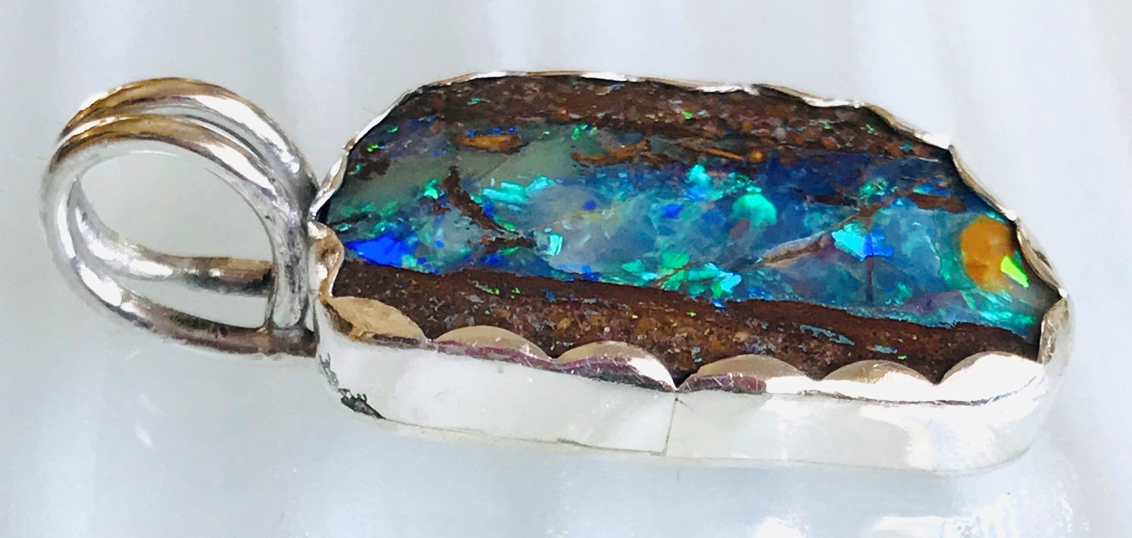 a river runs through boulder opal