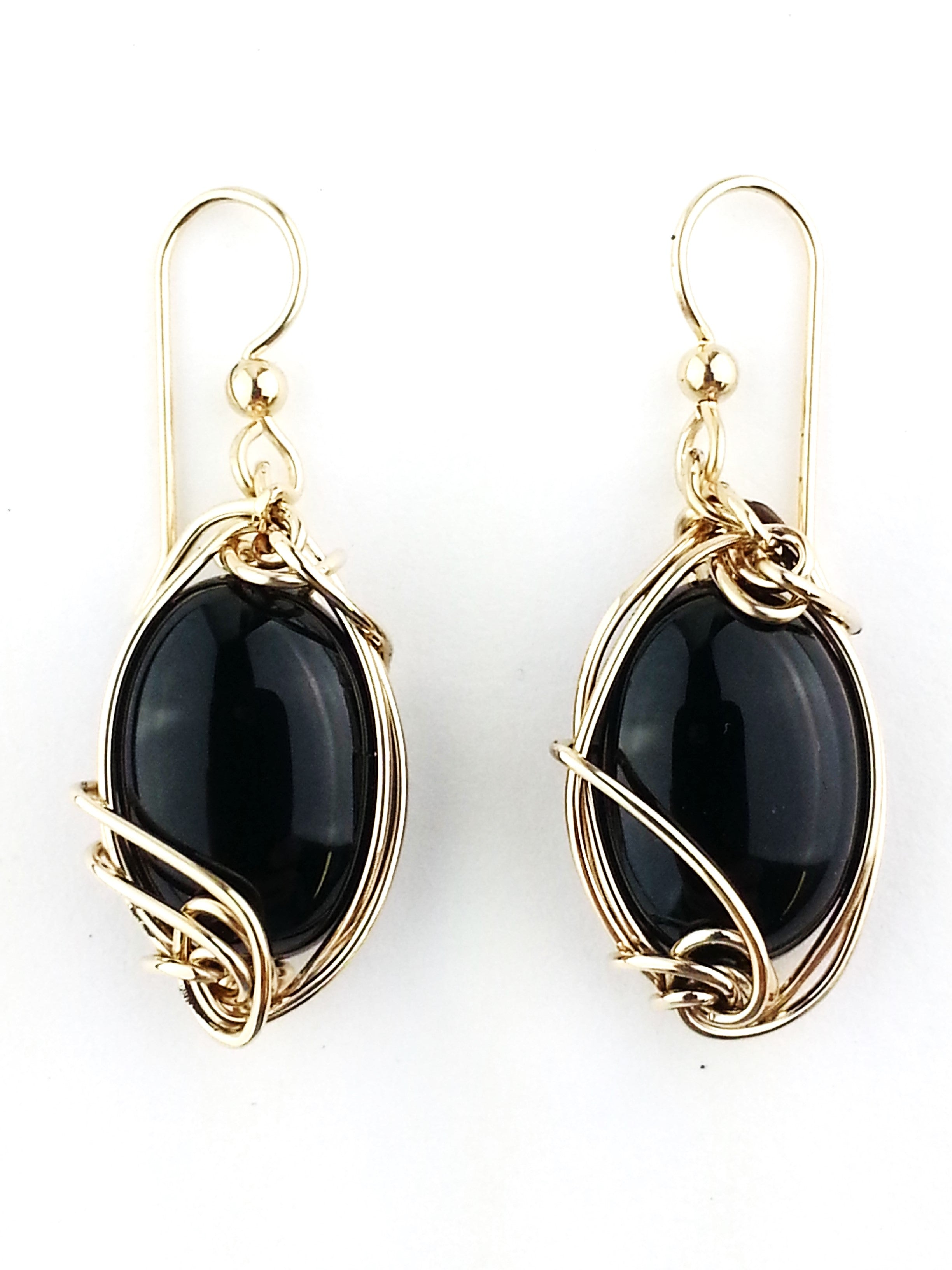 These Classic chic Black Onyx cabochon earrings contrast brilliantly when sculpted in 14kt gold filled (or Sterling Silver) wire and are a main staple that every woman's jewelry box simply should not be without.  Handcrafted in Minnesota, USA with the finest quality materials in my studio.