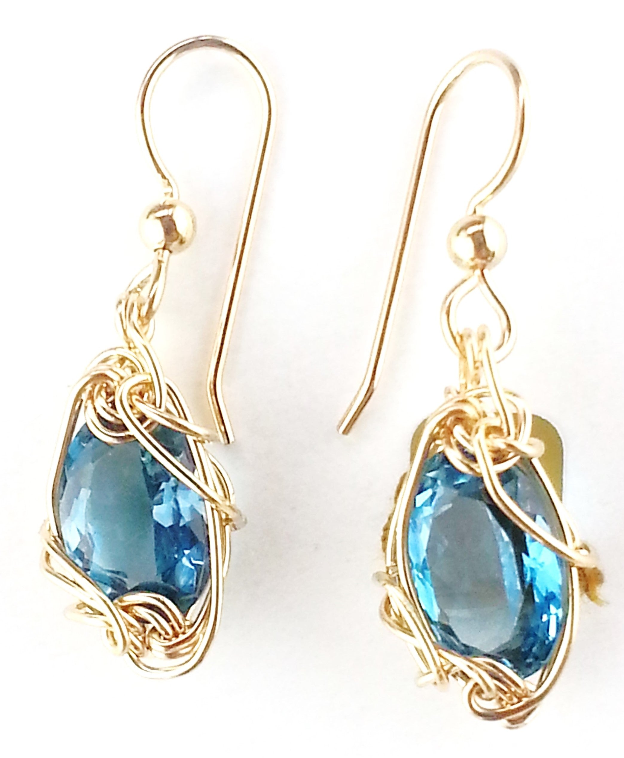 Sky Blue faceted oval cut dangling blue topaz earrings by earth in wire  from minnesota