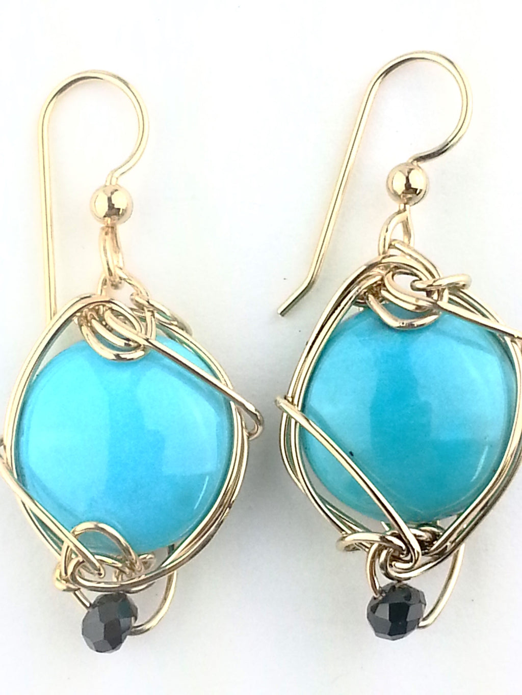 e Sleeping Beauty turquoise is a brilliant blue accented with faceted Black spinel. which creates a stunning, down right pretty look.   It is such a treasure to have a beautiful classic pair of American Turquoise in your collection.  Their versatility is endless as they are perfect with your favorite faded blue jeans or your finest formal.  When I travel, my turquoise are always with me!  Size 2.5 cm x 1.8 w cm Total Length with the ear wires 4.0 cm