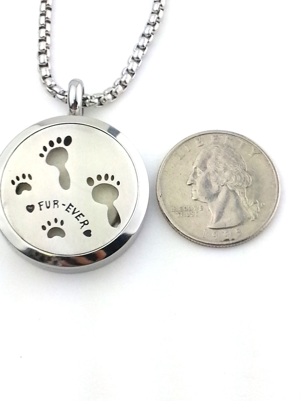 Essential oil diffuser necklace with Furever pawprints from Earth in Wire