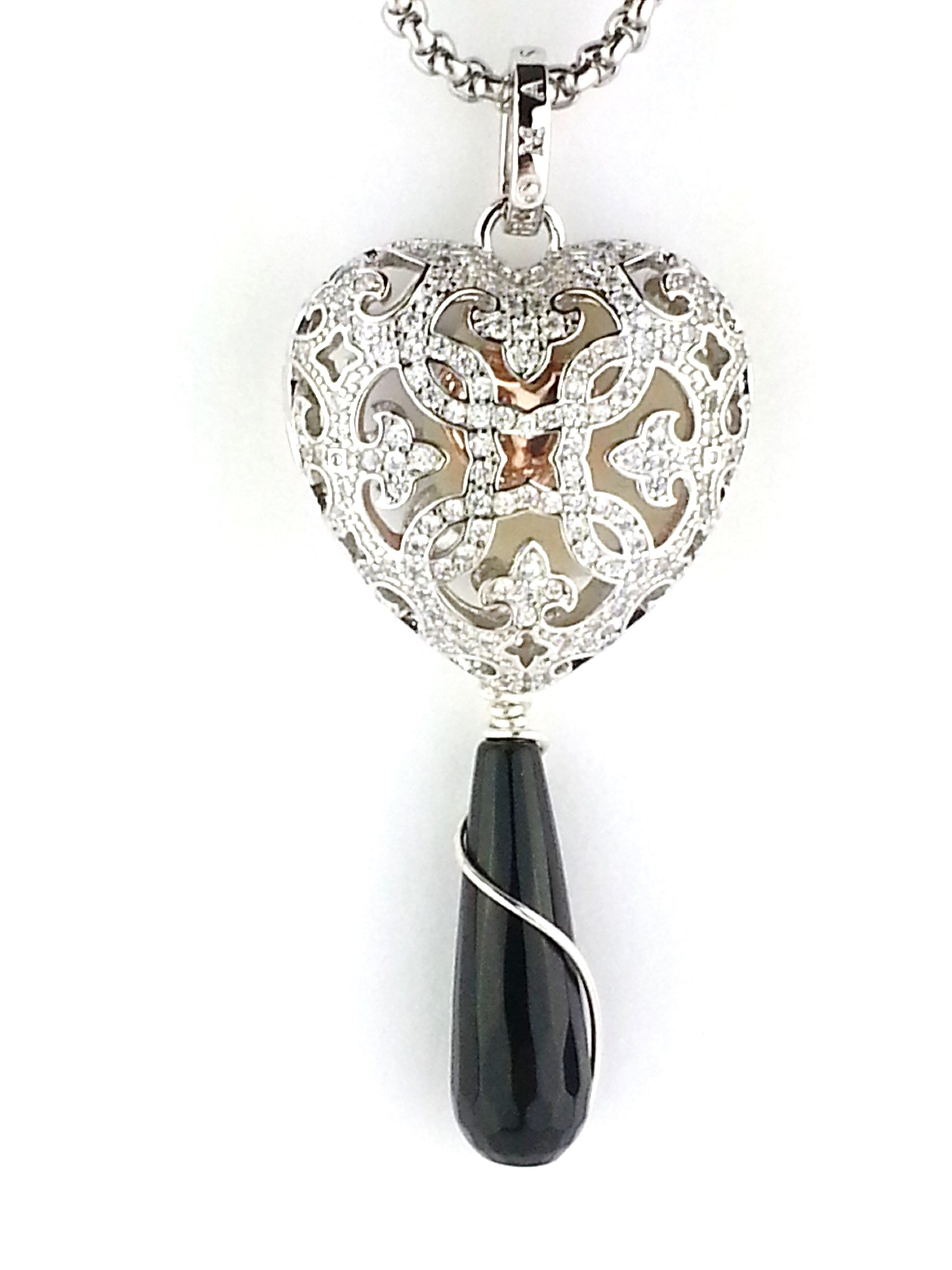 Essential oil heart shaped diffuser necklace with wire wrapped black onyx from Earth in Wire