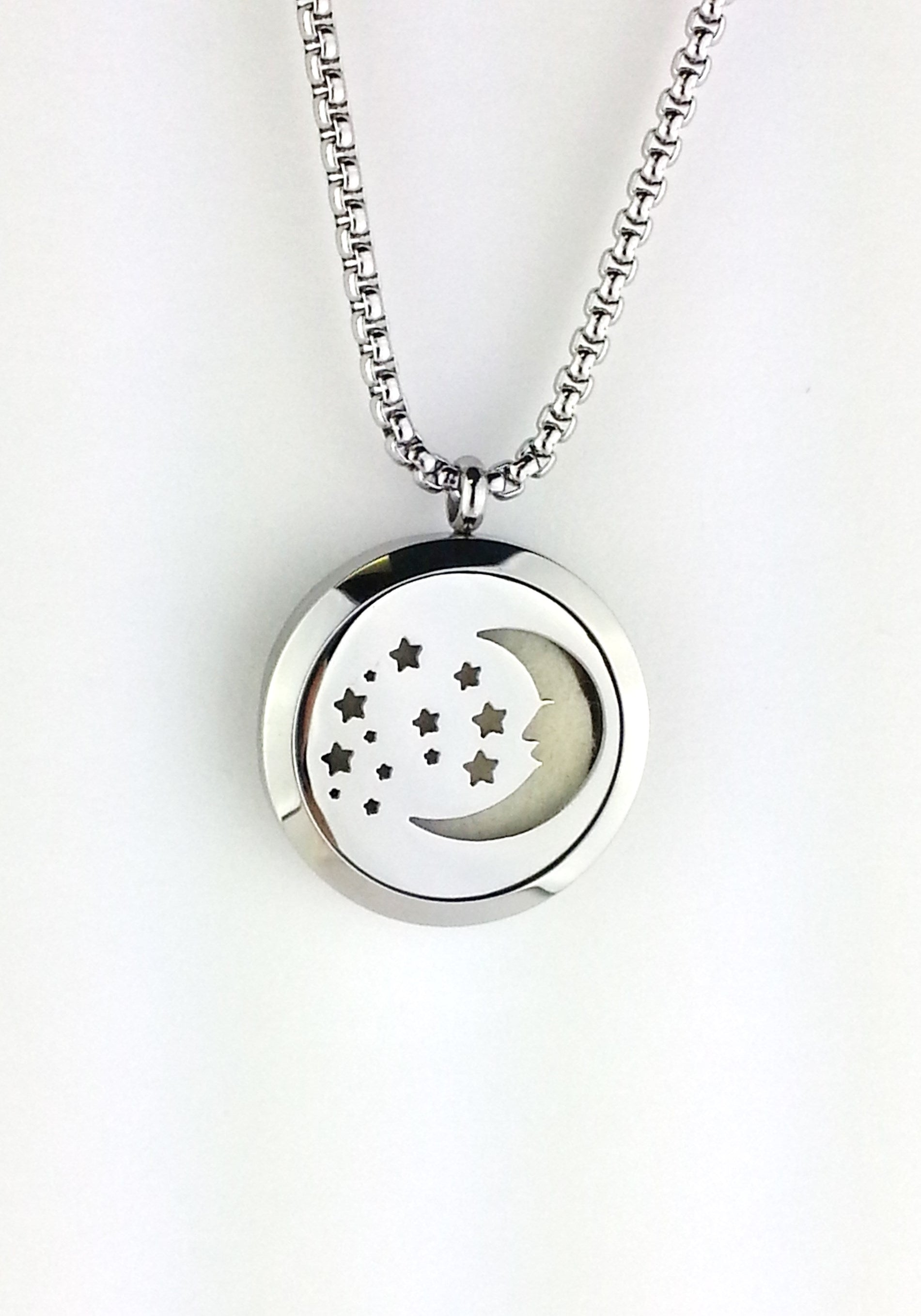 moon and stars diffuser locket necklace made of stainless steel on a stainless steel chain