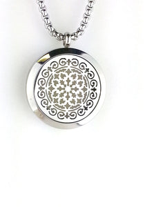 Stainless steel essential oil diffuser necklace locket with a Spanish Tile Design. Open your diffuser locket, and simply place a couple of drops of your favorite oil on the pad in the diffuser.  Diffuser Locket Size:30 mm diameter with a strong magnet closure & Flat Back. This locket is high quality 316 stainless steel