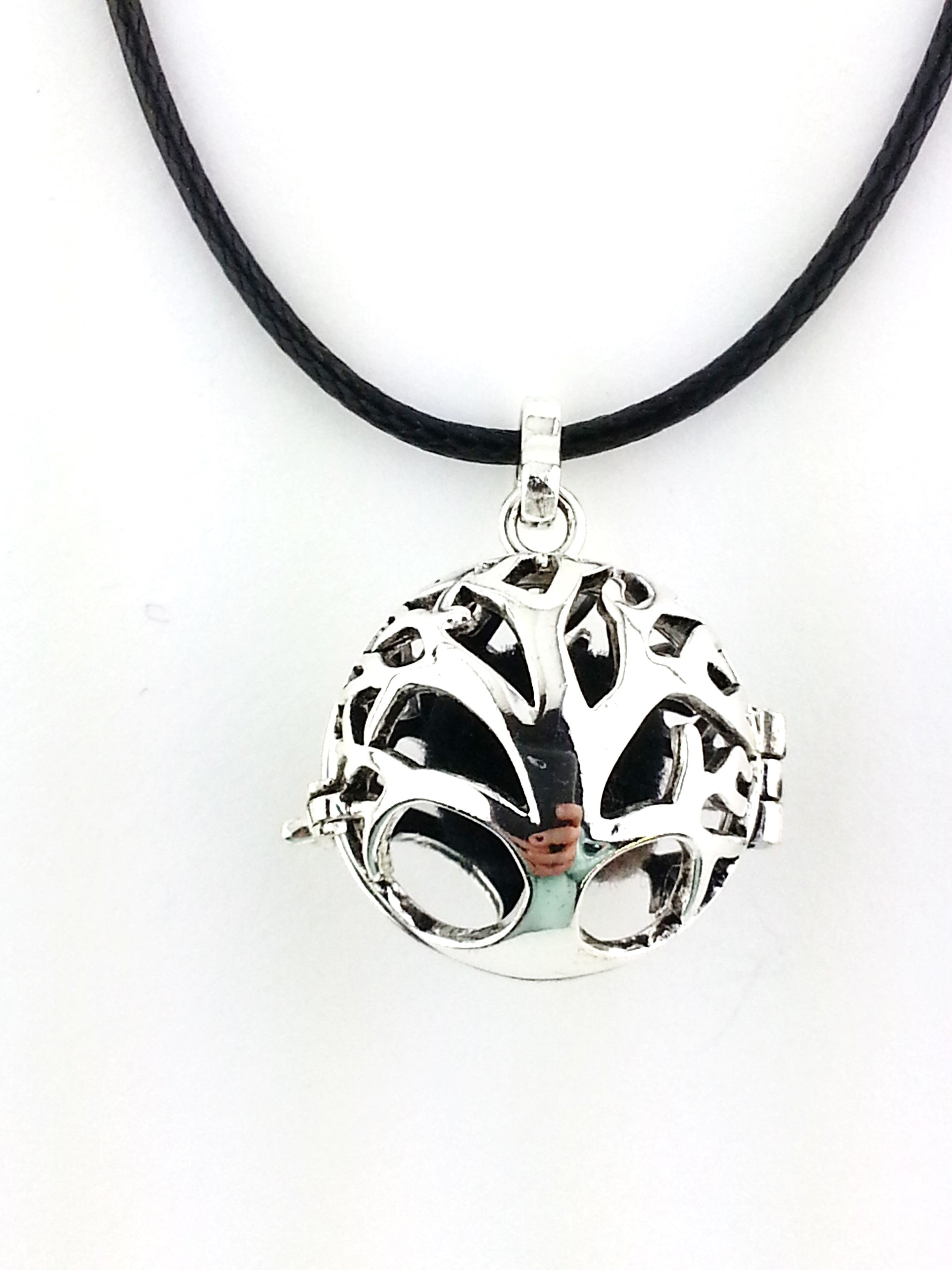 Essential Oil Tree of Life shaped into a ball that opens on the side with a hinge.  Inside is a felt ball for your essential oil,.      diffuser necklace by Earth in Wire