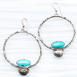 sterling silver hoops enhanced with Southwest Turquoise.  The natural beauty of this turquoise is always timeless.  I slightly hammered the sterling silver creating depth for blackened or oxidized silver.  The outer diameter of the hoops are 43 mm.   Top of sterling ear wire to bottom of  native inspired embellishment is 67mm.  Nothing says USA more than turquoise in silver.