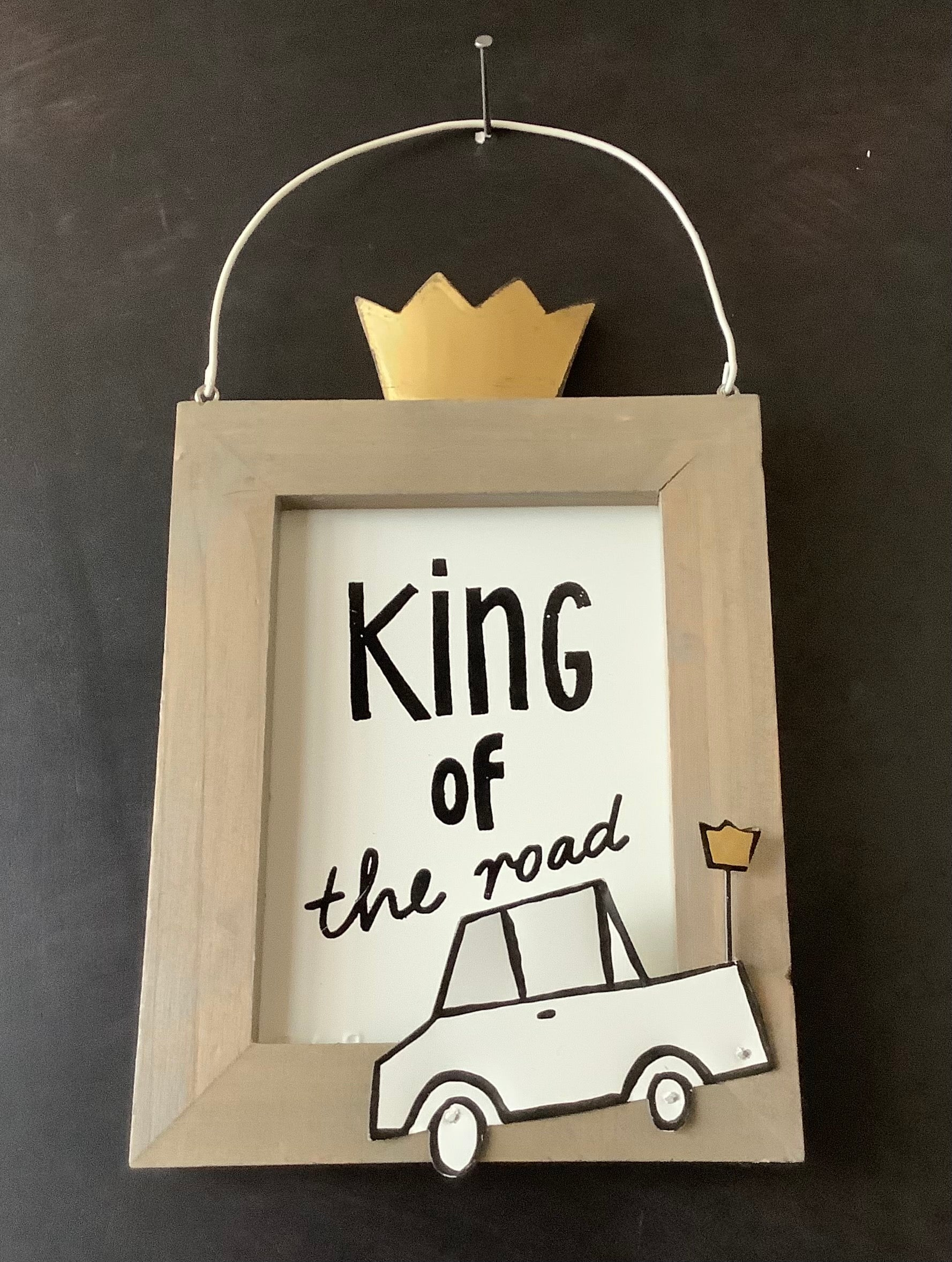 "Schild ""King of the road"""
