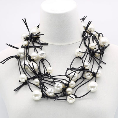 WHITE SMALL LOVE PEARLS WITH BLACK RUBBER