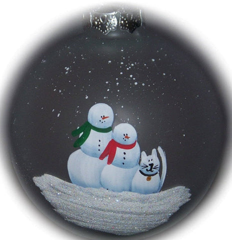 "Our family with a snow cat hand painted on a 3 1/4"" frosted glass ornament."