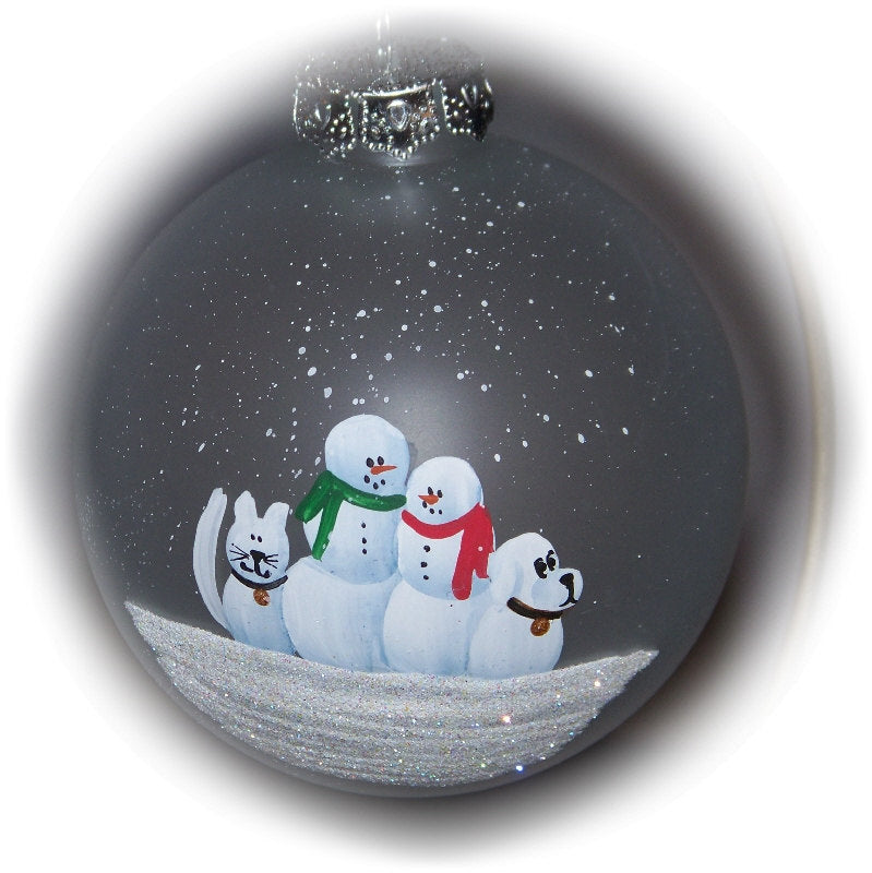 "Our family with a snow cat and snow dog hand painted on a 3 1/4"" frosted glass ornament."