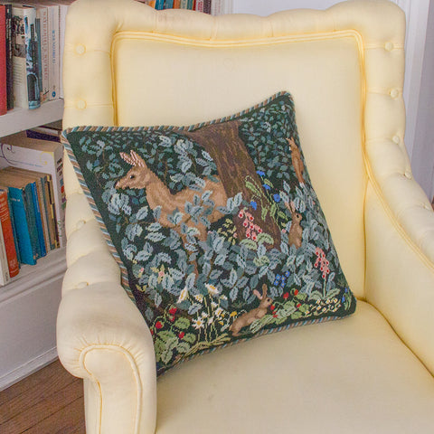 Woodland Cushion (dark) on yellow chair