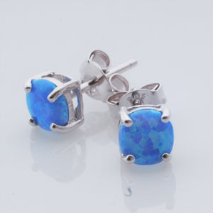 Earrings - Synthetic Blue Opal studs in Sterling