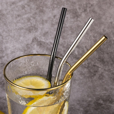 three metal straws in glass