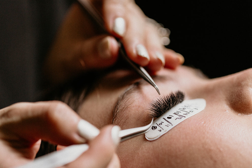 Closeup eyelash extension application
