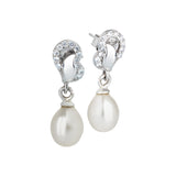Silver earrings with zircons and pearl to drop
