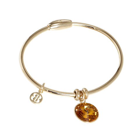 Bracelet with charm in Swarovski Crystal topaz