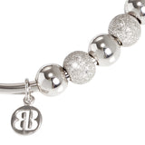 Bracelet rodiatos with smooth balls and the dotted