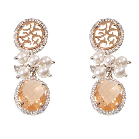 Earrings with a pin with a lobe, zircons and sprigs of Swarovski beads
