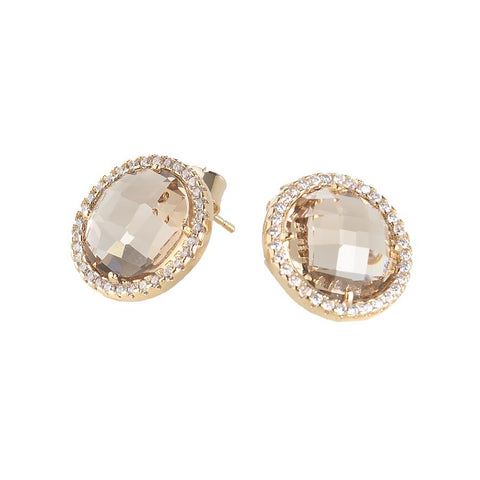 Earrings in the lobe with crystals champagne and zircons
