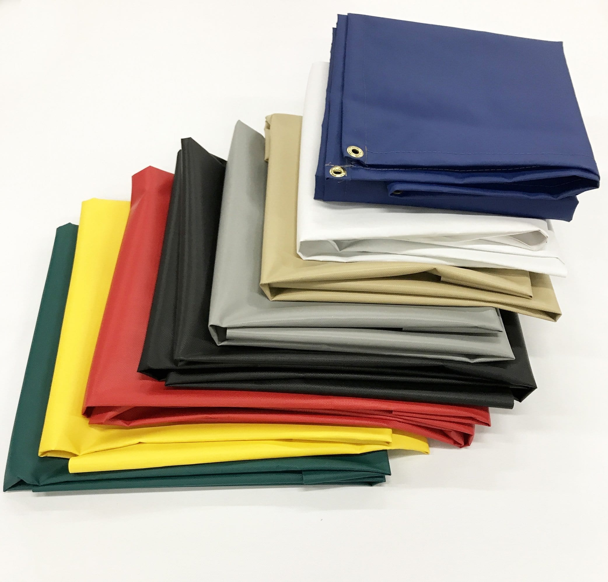 18 oz Vinyl Tarps in blue, black, white, yellow, red, green, & tan for heavy duty use