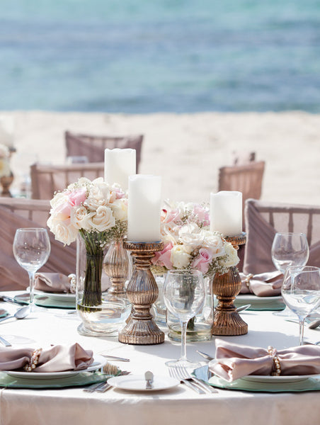 Blush table decor on the beach