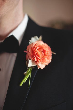 Groom with peach boutonniere