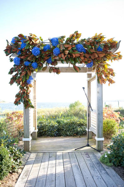 Wedding ceremony arch decorated with flowers