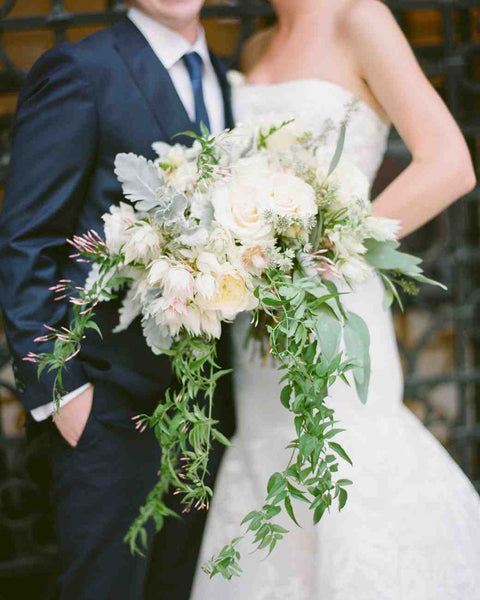 Bridal bouquet with roses, dusty miller and protea