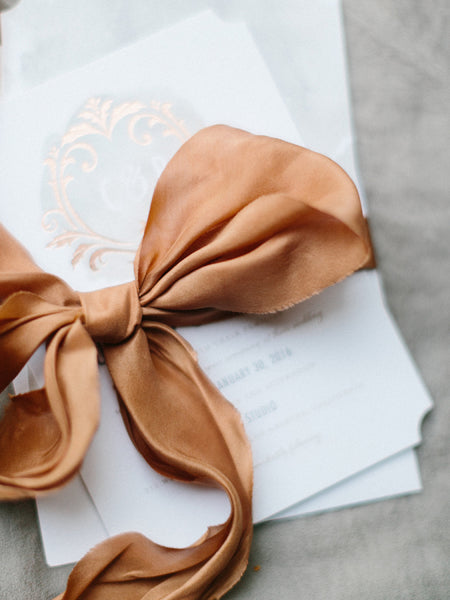 Wedding invitation with copper accents