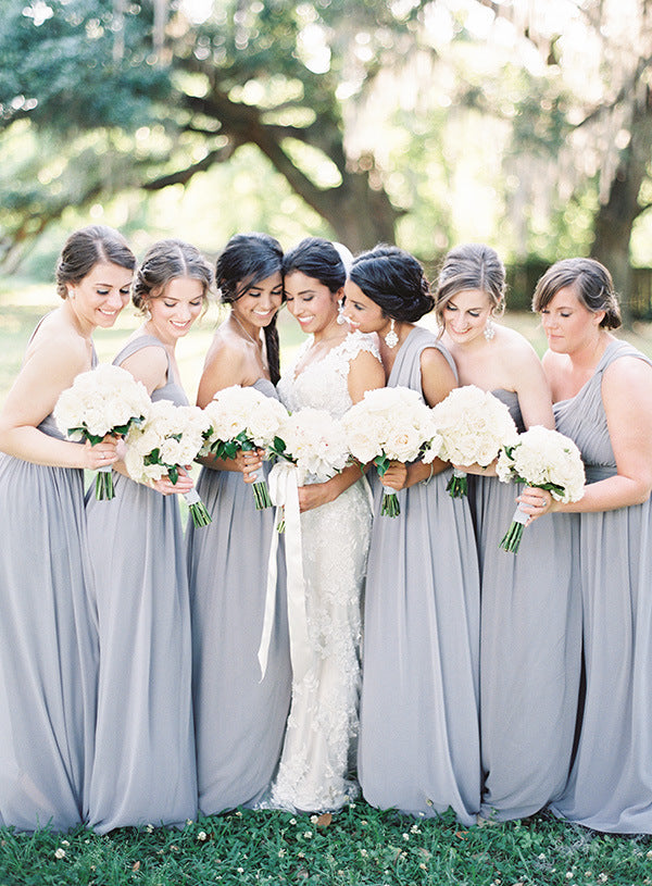 Bridesmaids in gray gowns