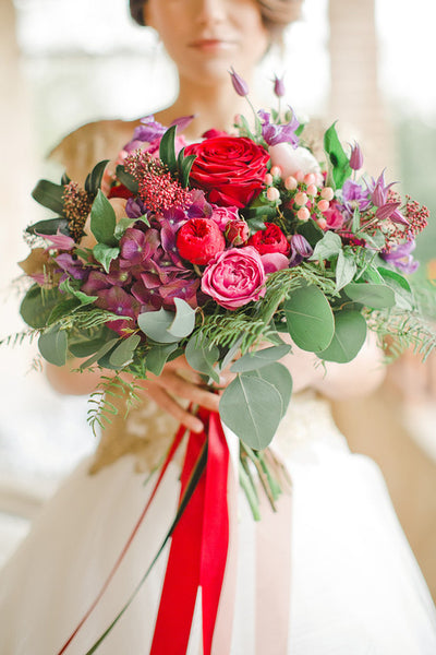 Colorful bouquet with red ribbon