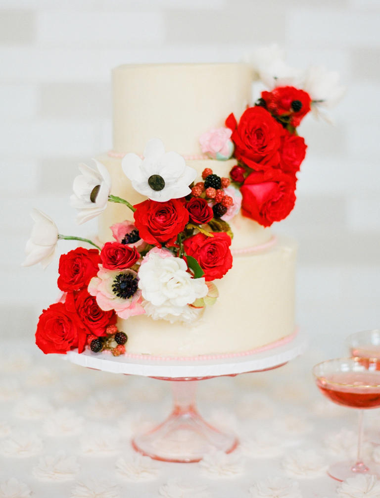 Wedding cake with red cascading roses