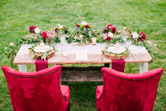 Red bride and groom chairs