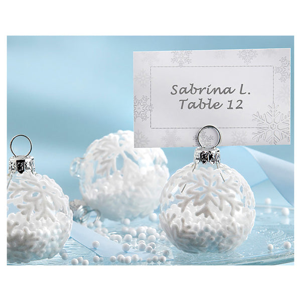 Glass ornament place card holder with snowflakes