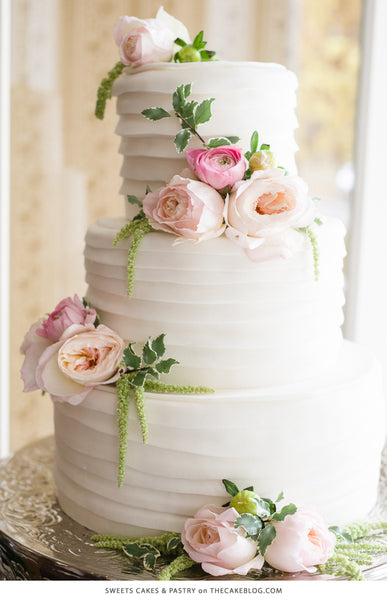 Wedding cake with pink flowers and greenery