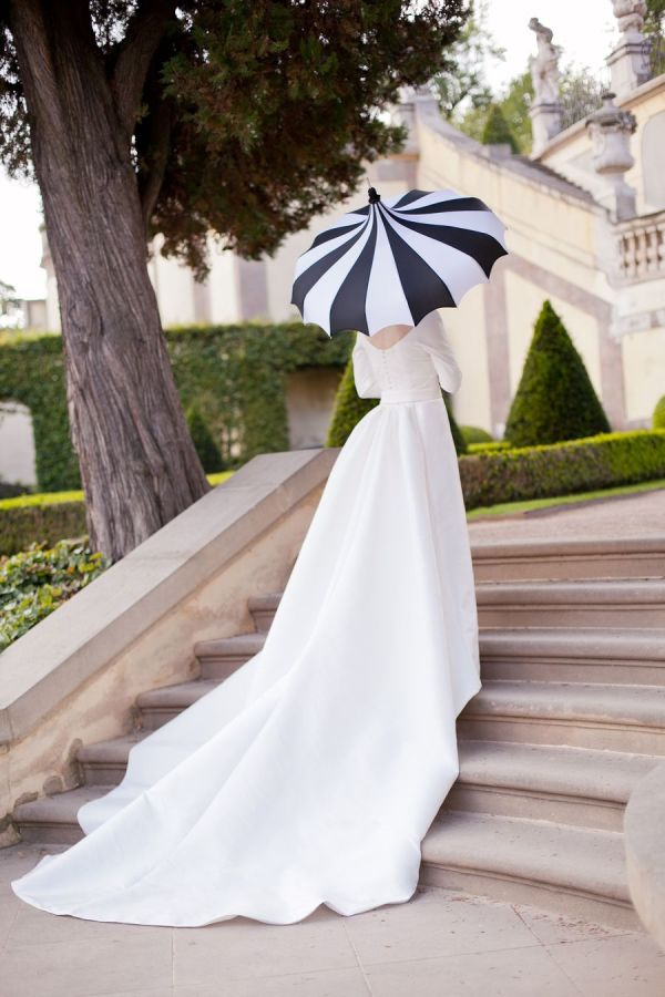 Bride with striped umbrella
