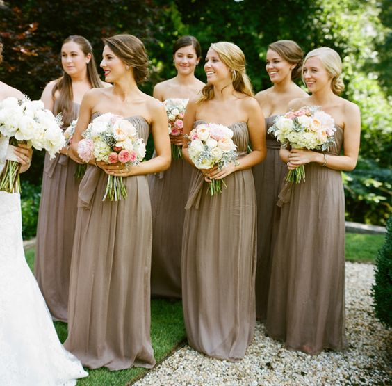 Bridesmaids in warm taupe gowns