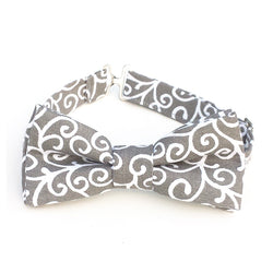 Gray bow tie with white swirls