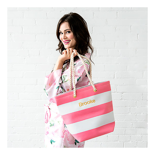 Pink and white striped tote bag on model