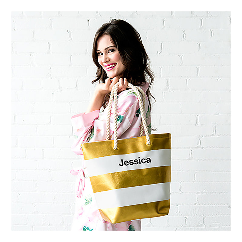 model with metallic gold and white stripe tote