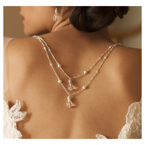 Back necklace with draped figaro chain in white or ivory