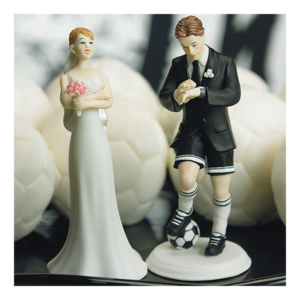 Soccer groom and bride cake toppers close up
